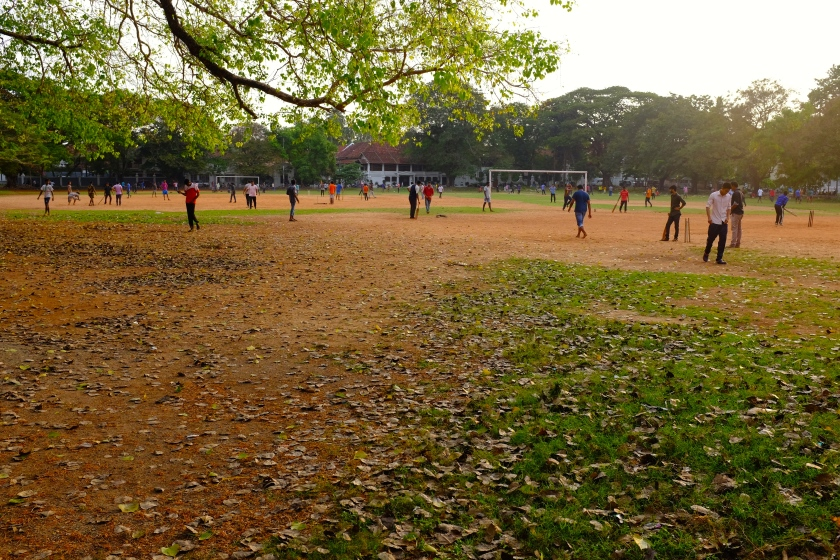Locals playing Cricket and Football on Parade Ground, Fort Kochi